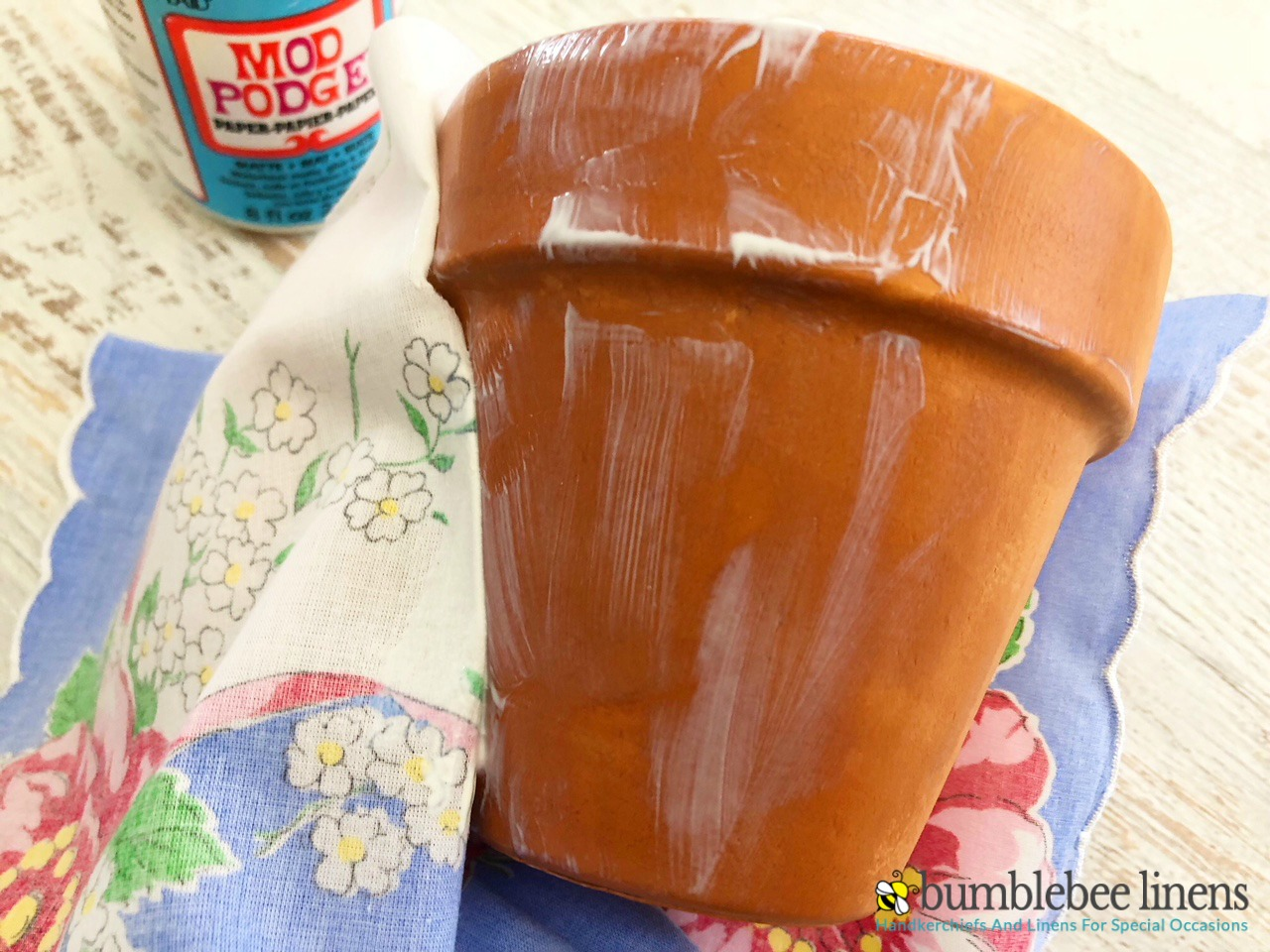 pot1Our Terra Cotta Pot Planter is a easy and beautiful way to spruce up a terra cotta pot with a little Mod Podge and a handkerchief.
