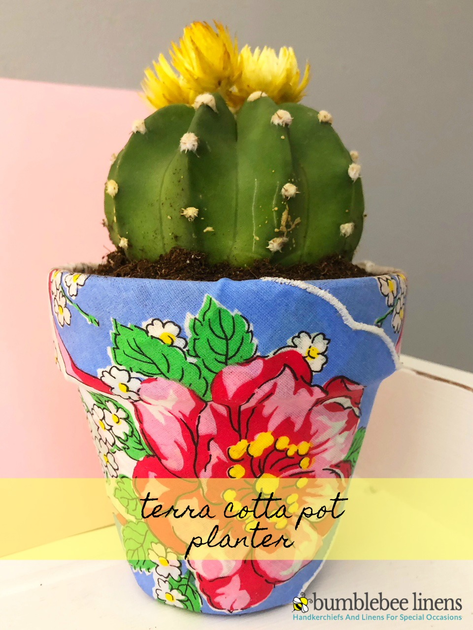 Our Terra Cotta Pot Planter is a easy and beautiful way to spruce up a terra cotta pot with a little Mod Podge and a handkerchief.