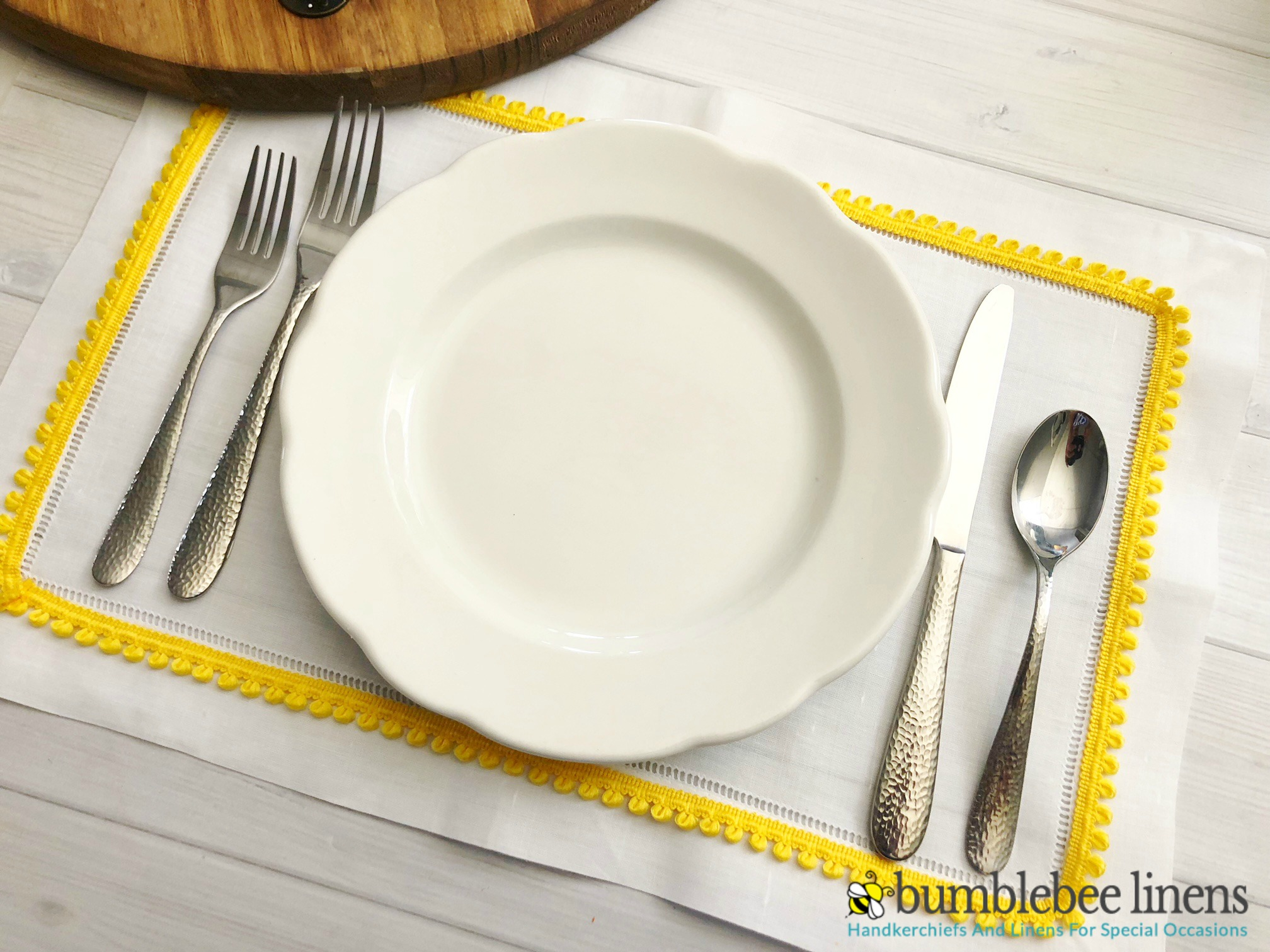 Learn how to Make No Sew Placemats to add a little color to your dinner table.