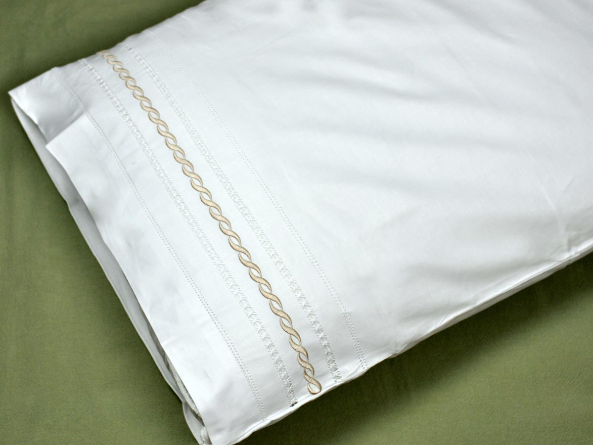 Pair of Cotton Pillowcases with an Bronze Infinity Design