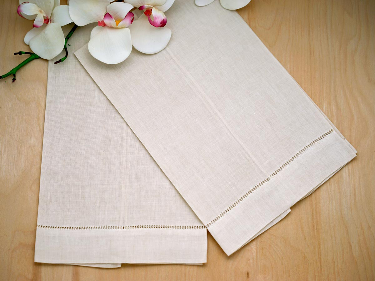 of 4 ecru linen hand towels with hemstitched edges