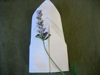 Folding A Napkin Into A Rosebud
